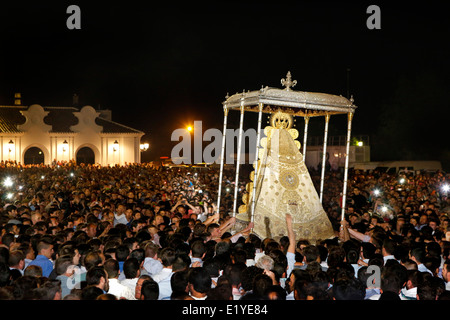 Thousands gather to touch the Virgin of El Rocío during the Romeria processionin Rocio in the province of Huelva, - Stock Photo