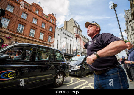 London, UK. 11th June, 2014. Taxi driver protest against Uber app in central London Credit:  Guy Corbishley/Alamy - Stock Photo