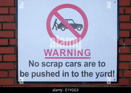 Warming, No scrap cars to be pushed in the Yard. Metal salvage yard in Manchester, UK - Stock Photo