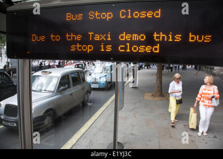 London, UK..11th June 2014. Black taxi drivers protest against taxi service app Uber, brings central London to a - Stock Photo