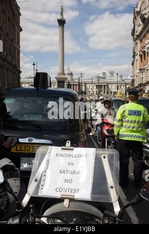 Black taxi cab drivers protest in Whitehall, central London, objecting to a new online booking and journey fare - Stock Photo