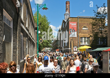 LONDON - JUNE 08, 2014: Tourists in Brick Lane on a busy sunny Sunday on June 08, 2014 in London. - Stock Photo