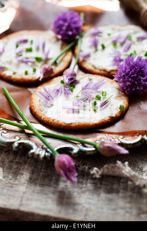 Crackers with fresh chives and cream cheese - Stock Photo