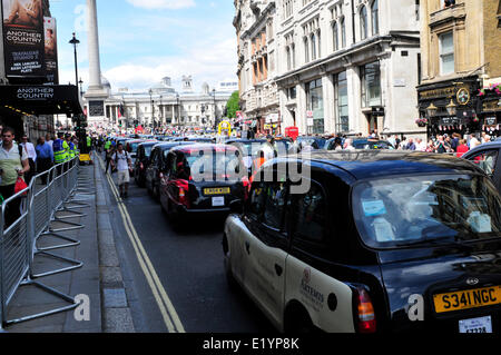 Black cab drivers block a road in central London - Stock Photo