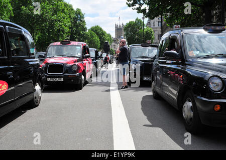 Black cab  drivers bring traffic to a standstill, Whitehall, London. - Stock Photo