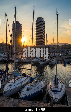 Boats in seaport at sunset, Barcelona. - Stock Photo