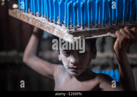 Rocky, aged 7, working in a balloon factory. -- Child workers in Bangladesh earn no more than USD per week, working - Stock Photo