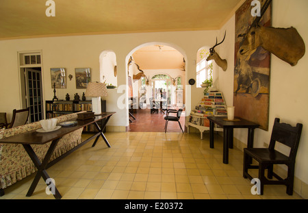 Interior of the historical home of writer Ernest Hemingway in Havana Cuba showing how he lived in San Francisco - Stock Photo
