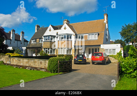 Typical suburban semi-detached houses, in Adel, near Leeds, West Yorkshire, England UK - Stock Photo