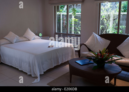 Rarotonga Island. Cook Island. Polynesia. South Pacific Ocean. Room and bed of luxury hotel Little Polynesian Resort - Stock Photo