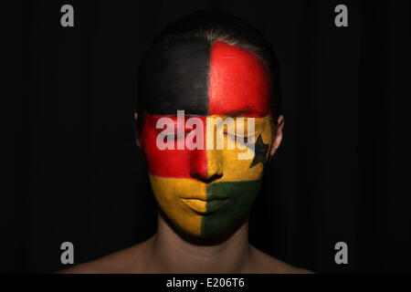 Duesseldorf, Germany. 11th June, 2014. ILLUSTRATION - Julia Gastel has her face painted in the colours of the German - Stock Photo