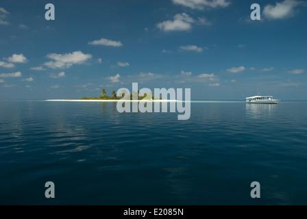 Very small tropical island in Ari Atoll, Maldives - Stock Photo