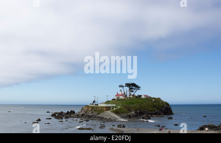 Historic Battery Point lighthouse situated near Crescent City, northern California, on the Pacific Ocean coast. - Stock Photo