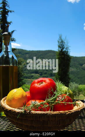 Tomatoes and lemons in Tuscany - Stock Photo