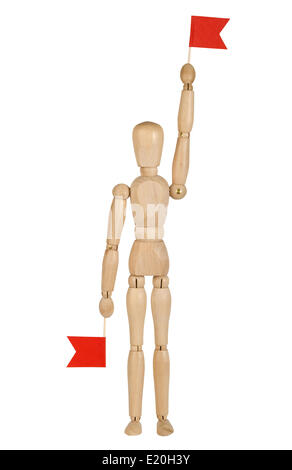 wooden toy man with red flags - Stock Photo