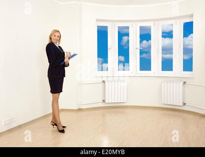 The realtor shows new apartment for sale - Stock Photo