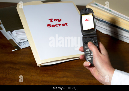 Woman using cell phone app to photograph and steal industry secrets - Stock Photo