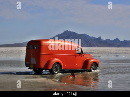 Flooded Bonneville Salt Flats in Utah with the dragster - Stock Photo