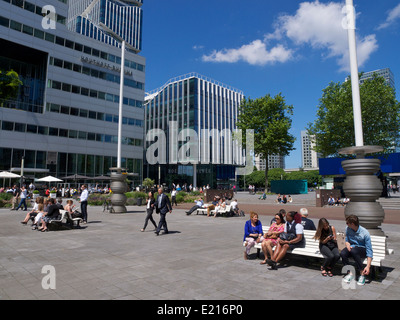 Zuidas financial district in Amsterdam with many people enjoying the sunshine. - Stock Photo