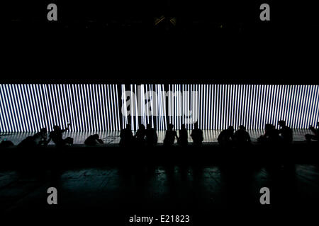 Barcelona, Spain. 12th June, 2014.Festival goers enjoy Carsten Nicolai's monumental audiovisual installation 'unidisplay' - Stock Photo