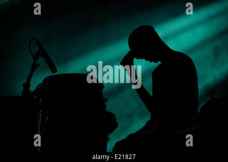 Barcelona, Spain. 12th June, 2014.A drummer awaits his part during Ben Frost's live set up at the 21st edition of - Stock Photo