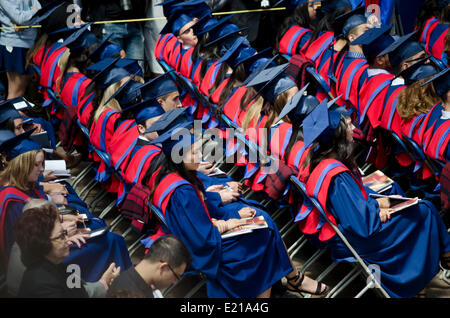 BURNABY, BC, CANADA.  JUNE 12, 2014:  Simon Fraser University graduates sitting in the audience during the Spring - Stock Photo