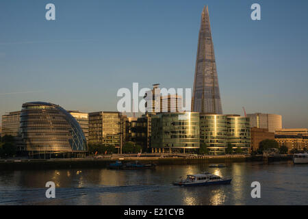 London, UK 13th June, 2014. The Shard skyscraper and City Hall bask in dawn light as London wakes to a beautiful - Stock Photo