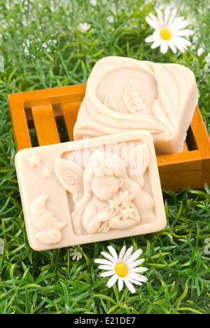 handmade soap on green grass - Stock Photo