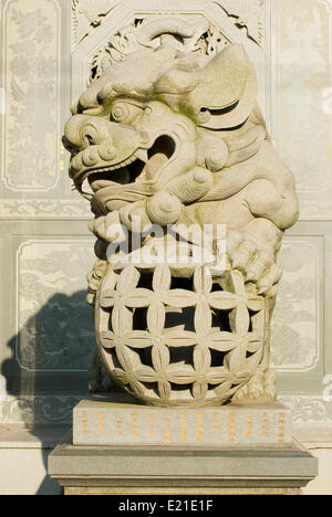 Traditional Chinese stone lion - Stock Photo