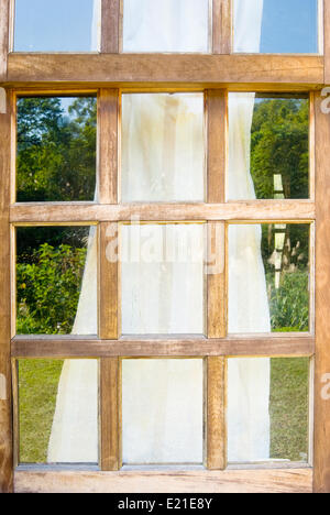 Old wooden windows with drape - Stock Photo