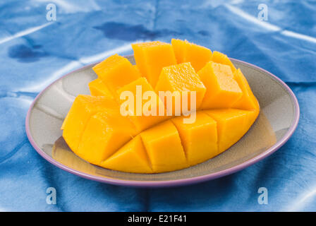 Fresh delicious mango fruit in dish - Stock Photo