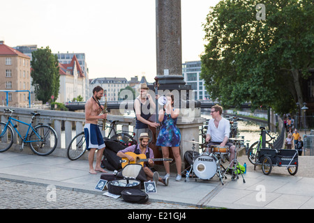 Street musicians in Berlin playing during an tango open air evening along the river Spree - Stock Photo