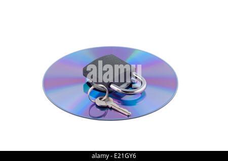 Padlock and key on cd isolated. - Stock Photo