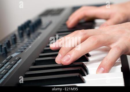 man playing piano - Stock Photo