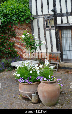 Cottage Garden Pots Flowers in clay pots in a cottage garden stock photo royalty free plant pots in cottage garden stock photo workwithnaturefo