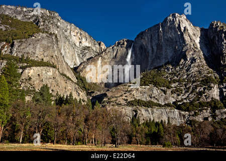 CALIFORNIA - Upper Yosemite Falls and Yosemite Point from the meadows of Yosemite Valley in Yosemite National Park. - Stock Photo