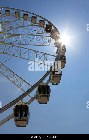 Madeira Drive, Brighton, Sussex. 13th June 2014. The sun beats down from a cloudless blue sky over the Brighton - Stock Photo