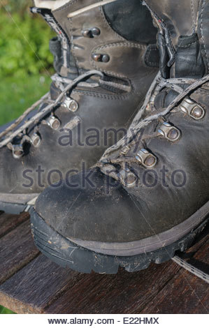 A well used pair of walking boots - Stock Photo