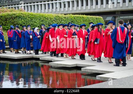 BURNABY, British Columbia,  CANADA.  JUNE 12, 2014:  Simon Fraser University graduands wait for the Spring 2014 - Stock Photo
