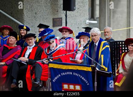 BURNABY, BC, CANADA.  JUNE 12, 2014:  Simon Fraser University President Andrew Petter addresses the graduands and - Stock Photo