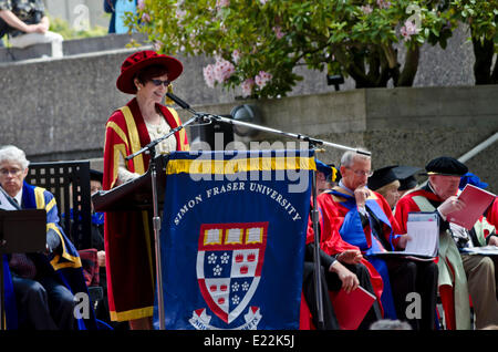 BURNABY, BC, CANADA.  JUNE 12, 2014:  Simon Fraser University Chancellor Dr. Carole Taylor speaks to graduands at - Stock Photo