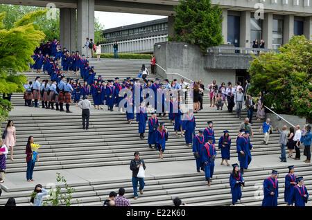 BURNABY, BC, CANADA.  JUNE 12, 2014:  Simon Fraser University graduands walk down the steps from the Academic Quadrangle - Stock Photo