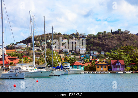 Yachts and houses in the Port Louis marina, in The Lagoon at St George's harbour, St George, Grenada, West Indies - Stock Photo