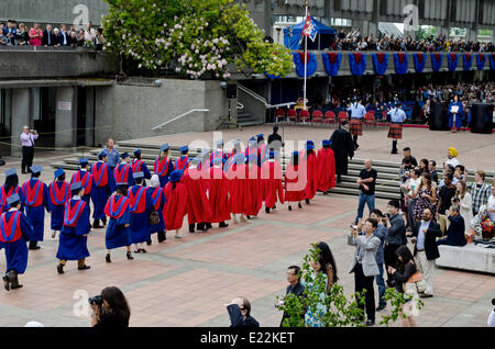 BURNABY, BC, CANADA.  JUNE 12, 2014:  Simon Fraser University graduands walk in procession towards the Convocation - Stock Photo