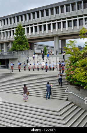 BURNABY, British Columbia, CANADA.  JUNE 12, 2014:  Simon Fraser University Pipe Band plays for the audience before - Stock Photo