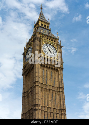 Upper section of Big Ben at the Palace of Westminster London England with the dial showing 4.55pm - Stock Photo