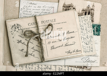 old letters and antique french postcards. vintage sentimental retro style background - Stock Photo