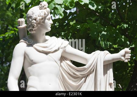 Marble sculpture of Apollo Belvedere 1820s sculptor P.Triskorni in the Summer Garden in St. Petersburg - Stock Photo
