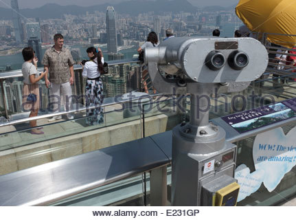 The binoculars at the top of Victoria Peak in Hong Kong looking out over the Vista of Kowloon Harbour. - Stock Photo