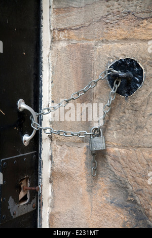 Padlocked door with chain to the wall Her Majesty's Prison Lancaster Castle, Castle Park Lancashire, England UK - Stock Photo